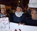 חבר הכנסת באסל גטאס בראש ההפגנה הלא חוקית אתמול בחיפה. אחרי שהבריח ניידים למחבלים מסית מבלי שאיש יעצור אותו. צילום: פייסבוק