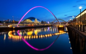 19489450 - the gateshead millennium bridge is a pedestrian and cyclist tilt bridge spanning the river tyne in england between gateshead s quays arts quarter on the south bank, and the quayside of newcastle upon tyne on the north bank